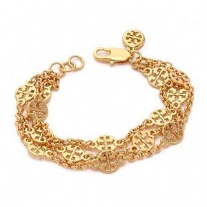 Tory Burch Gold TT Logo three ring bracelet
